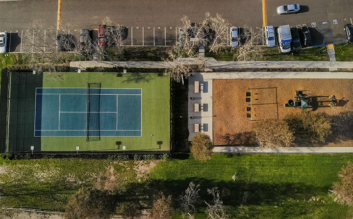 Aerial view of tennis court and playground at The Ranch at Moorpark, Moorpark apartments