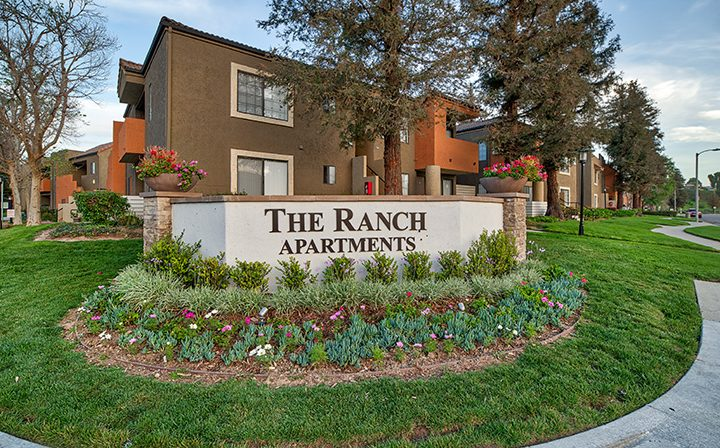 Placard in landscaped area designating an entrance to The Ranch at Moorpark, apartments in Moorpark