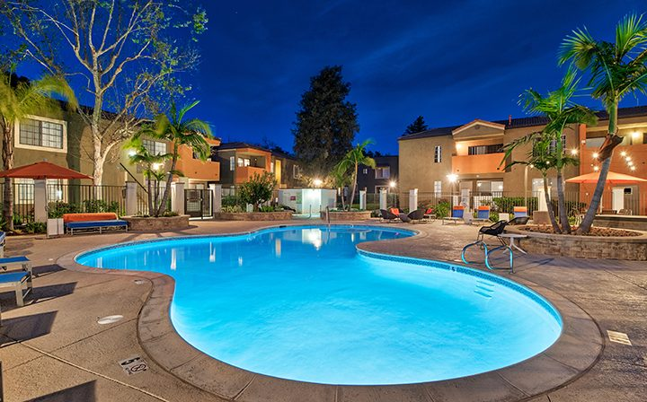 Large curved resort-style-pool at night at The Ranch at Moorpark, Moorpark apartments
