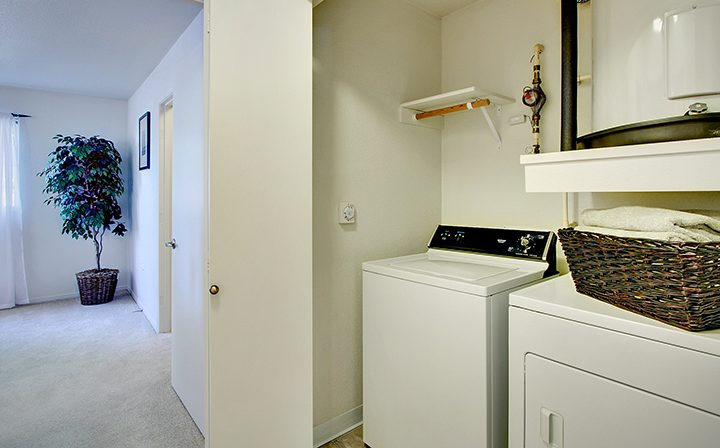 Sunny interior with in-unit washer and dryer at Seattle area apartment The Retreat at Bothell