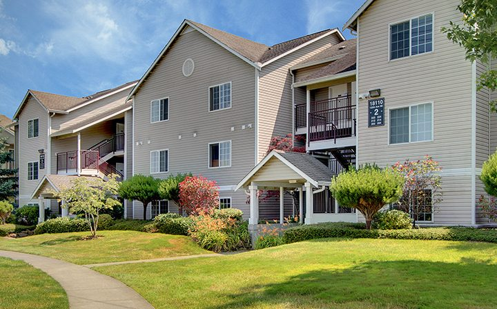 Landscaped exterior view of Seattle area apartments and grounds at The Retreat at Bothell
