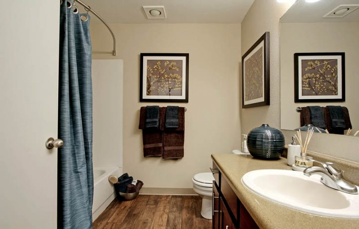 The Retreat at Bothell apartments bathroom interior with shower bathtub combo, sink, and toilet