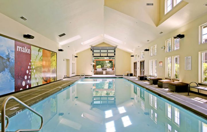 Large indoor pool with vaulted ceiling at Seattle area apartments The Retreat at Bothell