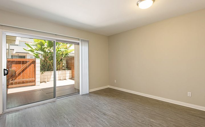 First floor bedroom interior with spacious patio at The Retreat at Thousand Oaks apartments