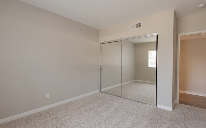 Unfurnished The Retreat at Thousand Oaks apartment bedroom interior with mirrored closet doors