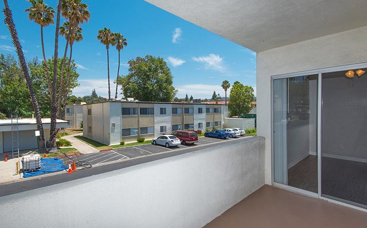 Spacious balcony with sunny palm tree street view at The Retreat at Thousand Oaks apartments