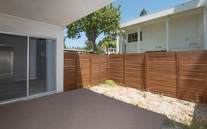 Large patio with wooden fence and sliding glass door at The Retreat at Thousand Oaks apartments