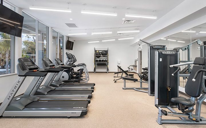 Treadmills and weight machines at The Retreat at Thousand Oaks apartments fitness center