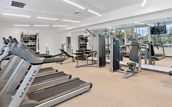 Treadmills with sunny window view at The Retreat at Thousand Oaks apartments fitness center