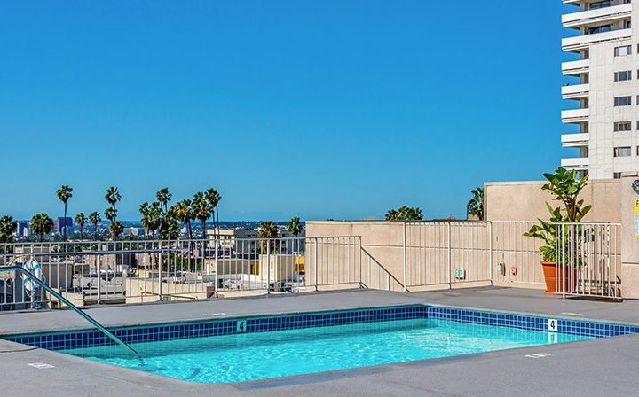 Palm trees visible from rooftop pool at The Ruby Hollywood, Hollywood apartments in Los Angeles