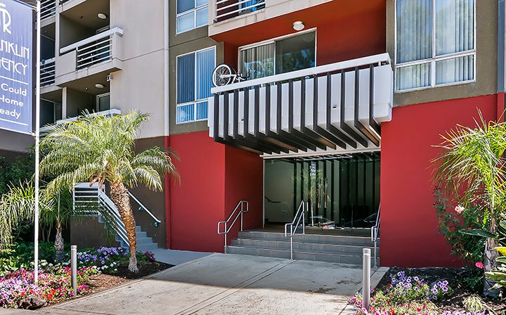 Entrance to The Ruby Hollywood, Hollywood apartments in Los Angeles, with red accent walls