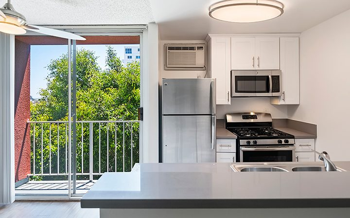 Kitchen next to balcony exit at The Ruby Hollywood, Los Angeles apartments in Hollywood