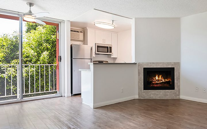 Unfurnished living room with fireplace at The Ruby Hollywood, Hollywood apartments in Los Angeles