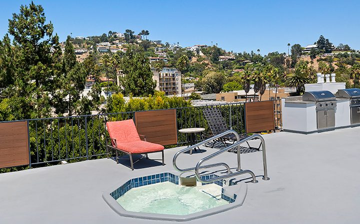 Hot tub near rooftop pool at The Ruby Hollywood, Hollywood apartments in Los Angeles
