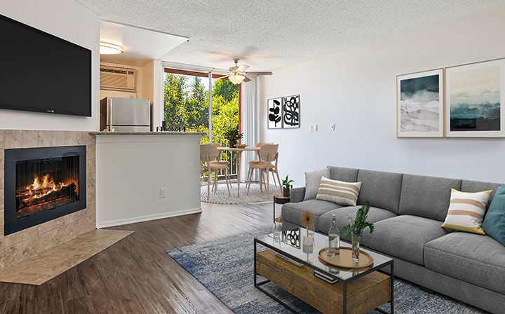 Furnished living room with fireplace at The Ruby Hollywood, Hollywood apartments in Los Angeles