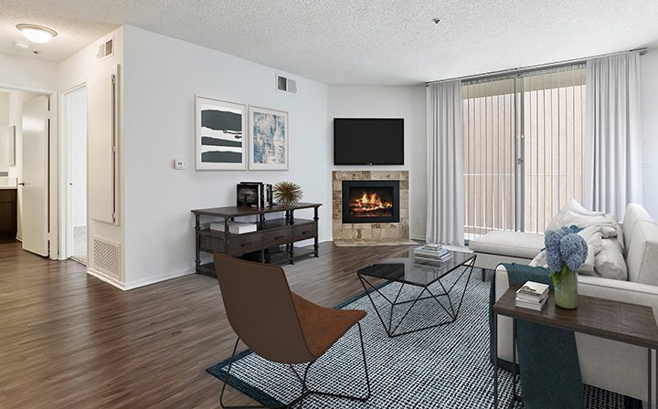 Furnished living room with fireplace at The Ruby Hollywood, Los Angeles apartments in Hollywood