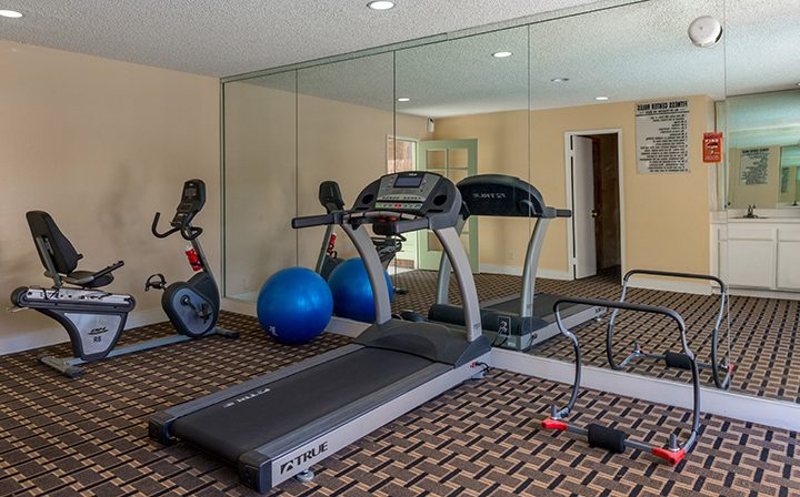 Mirrored wall in fitness center at Villa Bianca, West Hollywood apartments in Los Angeles