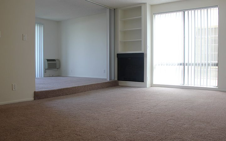 Carpeted, unfurnished living room at Villa Bianca, West Hollywood apartments in Los Angeles