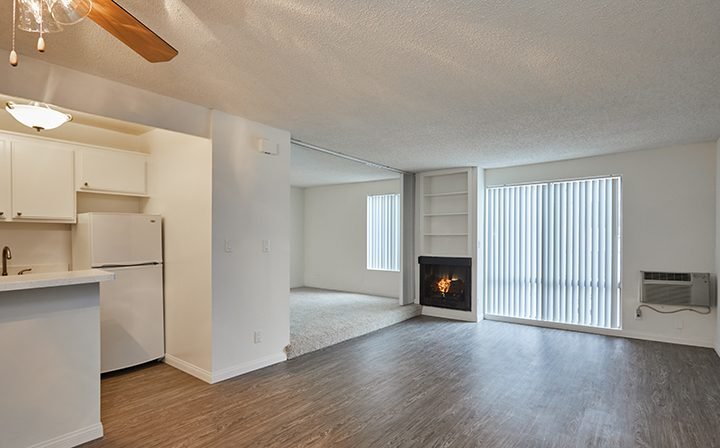 Unfurnished living room with fireplace at Villa Bianca, Los Angeles apartments in West Hollywood