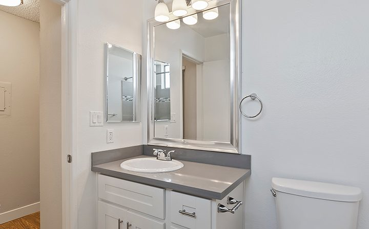 Bathroom vanity with lights at Villa Bianca, Los Angeles apartments in West Hollywood
