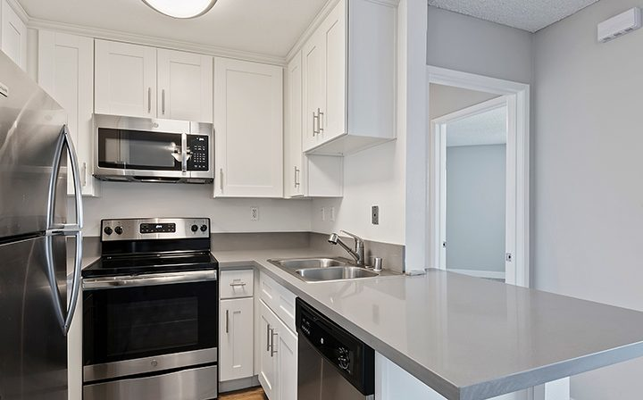 Unfurnished kitchen with white cabinets at Villa Bianca, Los Angeles apartments in West Hollywood