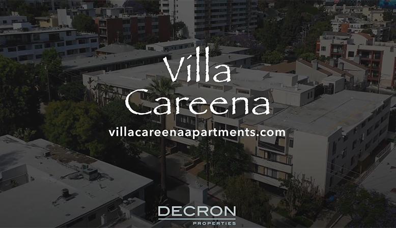 Aerial city video still text overlay: Villa Careena - villacareenaapartments.com - Decron Properties