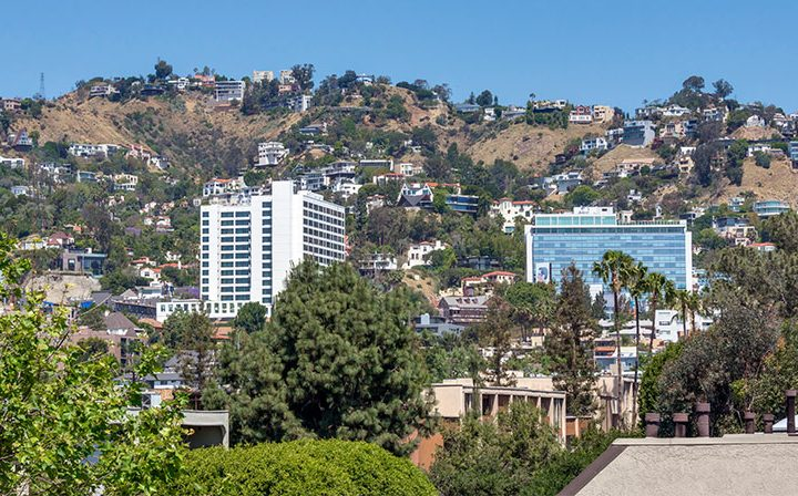 Buildings nestled in hills visible from Villa Esther, Los Angeles apartments in West Hollywood