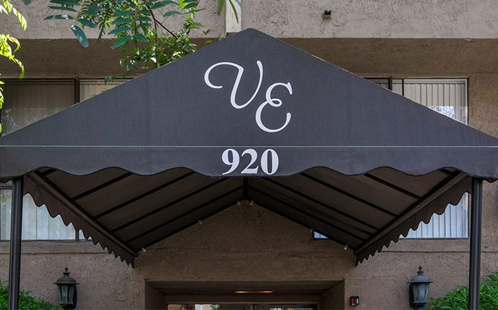 Entrance to Villa Esther, West Hollywood apartments in Los Angeles, with awning reading VE 920