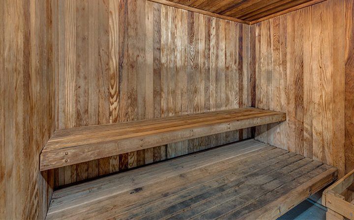 Wooden bench in shared sauna amenity at Villa Esther, Los Angeles apartments in West Hollywood