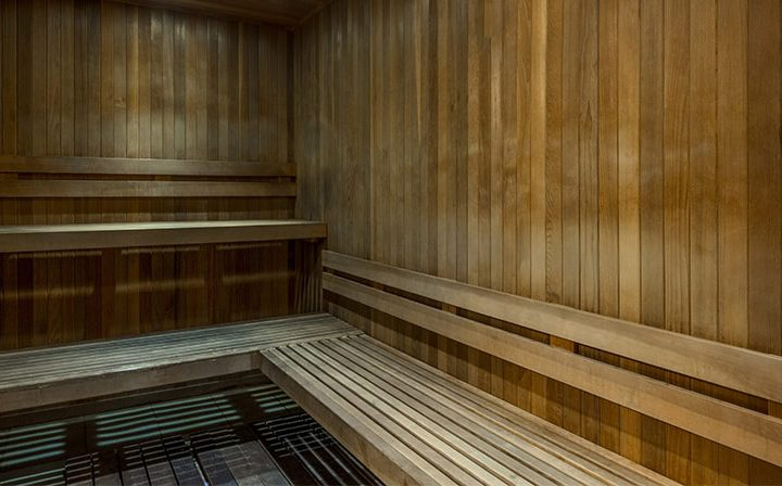 Wood bench in shared sauna amenity at Villa Francisca, Los Angeles apartments in West Hollywood