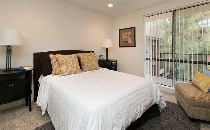Furnished bedroom with balcony exit at Villa Francisca, Los Angeles apartments in West Hollywood
