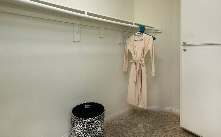 Closet with hanging robe as example at Villa Francisca, West Hollywood apartments in Los Angeles