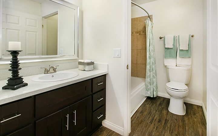 Furnished bathroom with black cabinets at Villa Francisca, Los Angeles apartments in West Hollywood