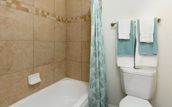 Sea foam green towels in bathroom at Villa Francisca, West Hollywood apartments in Los Angeles
