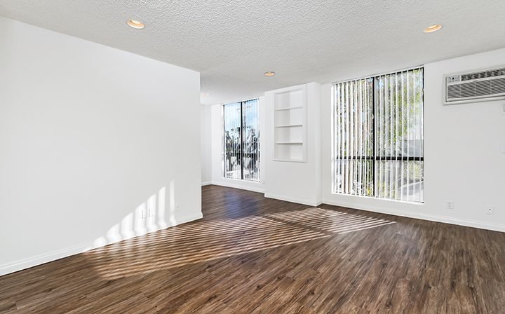 Sunny, unfurnished living room at Villa Francisca, Los Angeles apartments in West Hollywood