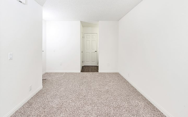 Carpeted, unfurnished unit hallway at Villa Francisca, Los Angeles apartments in West Hollywood