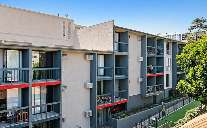 Unit balconies with orange accents at Villa Francisca, Los Angeles apartments in West Hollywood
