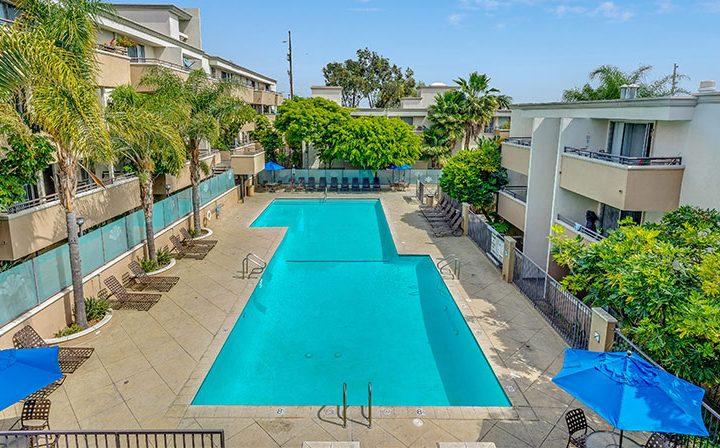 Large resort-style pool between apartments at Westside Terrace, apartments in West Los Angeles