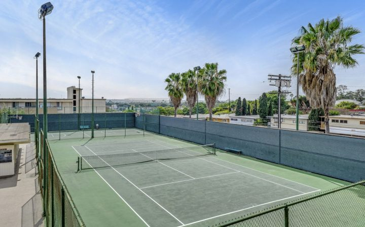 Outdoor tennis court by palm trees at Westside Terrace, West Los Angeles apartments