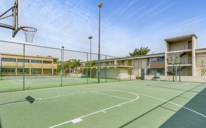 Basketball court outdoors with green surface at Westside Terrace, apartments in West Los Angeles