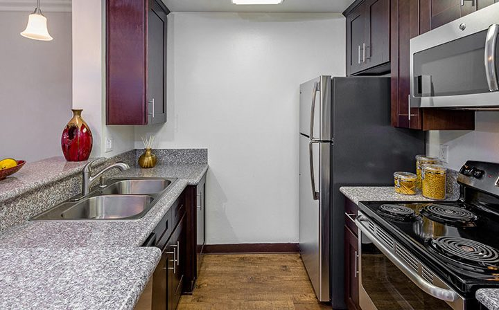 Furnished kitchen with sink adjacent stove at Westside Terrace, West Los Angeles apartments