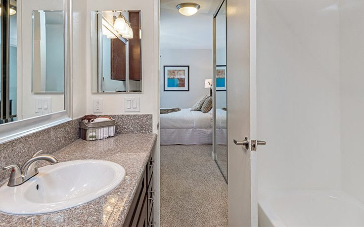 Well-lit bathroom looking out at bedroom at Westside Terrace, apartments in West Los Angeles
