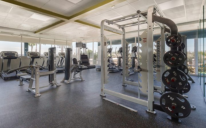 Weight racks and other fitness equipment at Westside Terrace, apartments in West Los Angeles