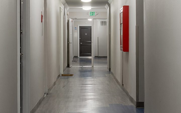 Corridor between units with white walls at Westside Terrace, apartments in West Los Angeles