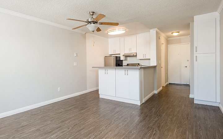 Unfurnished kitchen area with white cabinets at Westside Terrace, West Los Angeles apartments