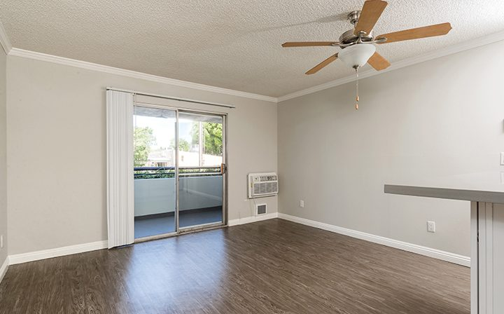 Sunny, unfurnished living room with balcony exit at Westside Terrace, apartments in West Los Angeles