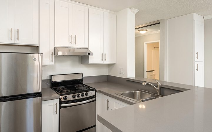 Unfurnished kitchen corner white cabinets at Westside Terrace, apartments in West Los Angeles