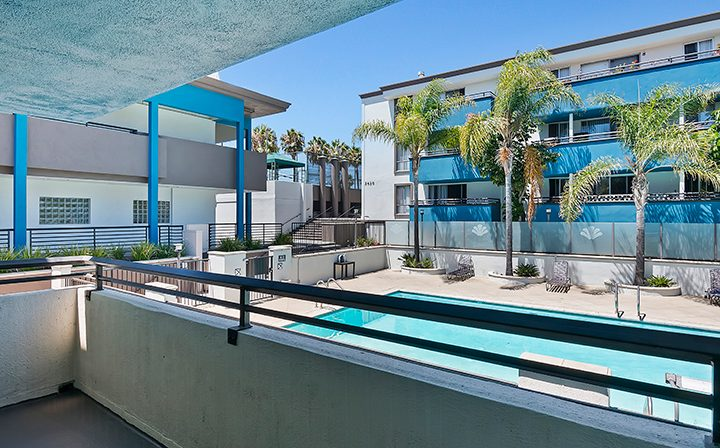 Apartment balcony overlooking pool at Westside Terrace, apartments in West Los Angeles