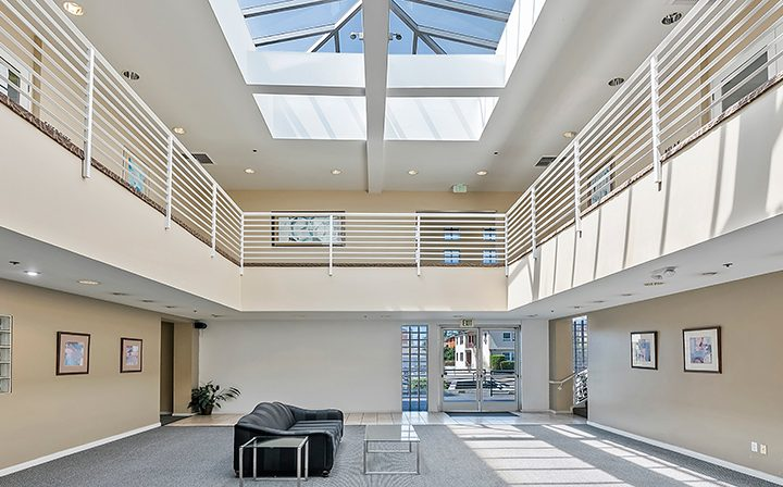 Decorated lobby with second floor and skylight at Westside Terrace, West Los Angeles apartments