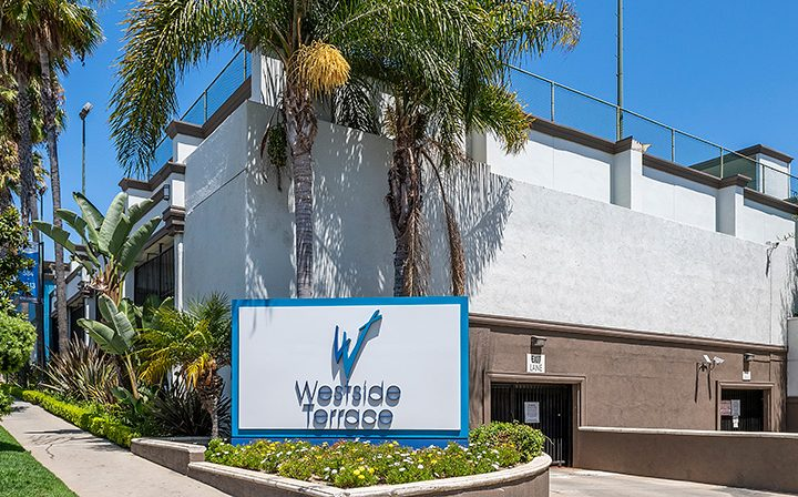 Entry sign with logo and name at Westside Terrace, apartments in West Los Angeles